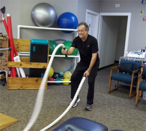 Exercise ropes in use to strengthen back and core.